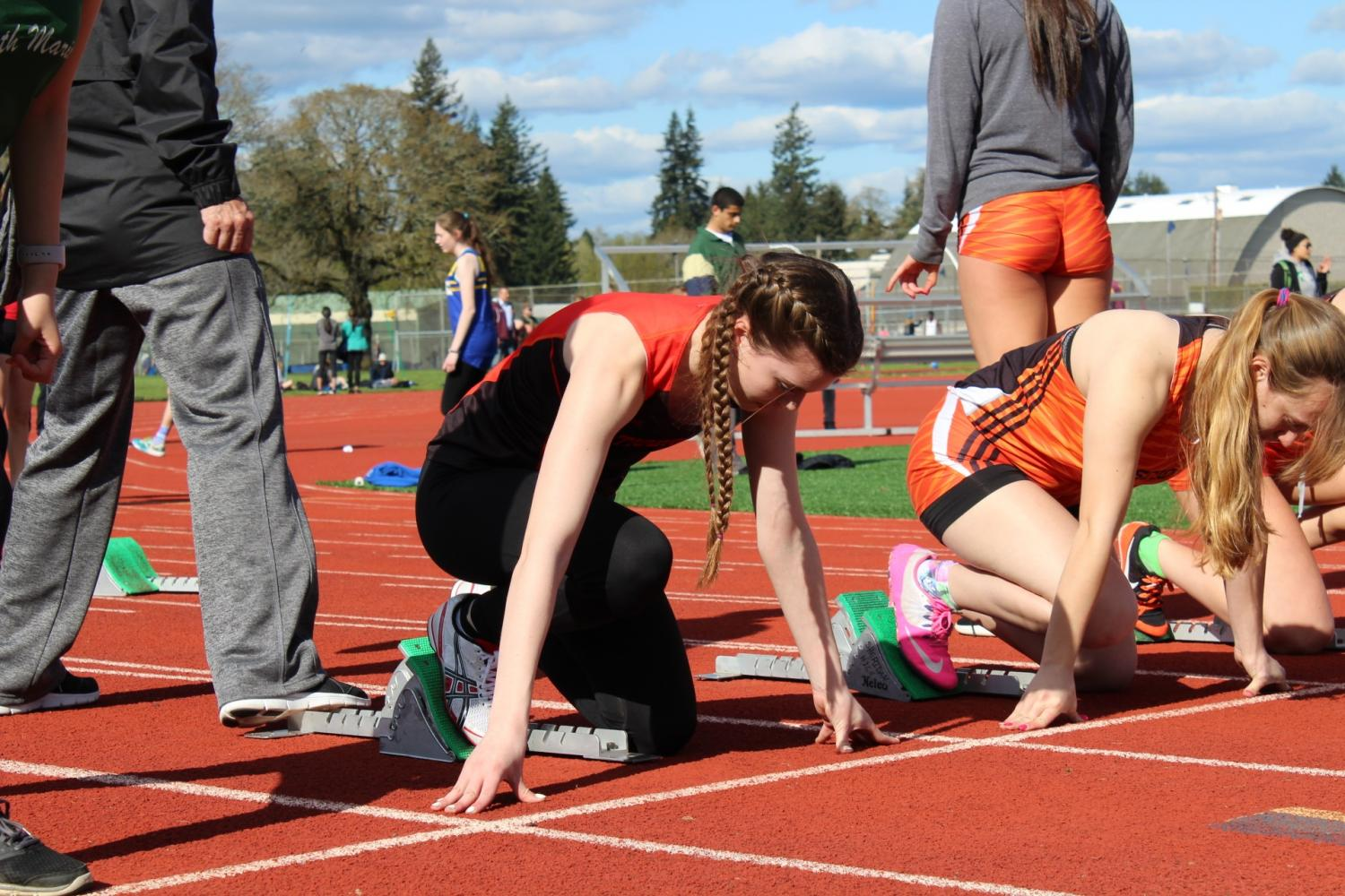 Jensyn Stanger getting ready in the blocks at the Stayton Twilight Track Meet.