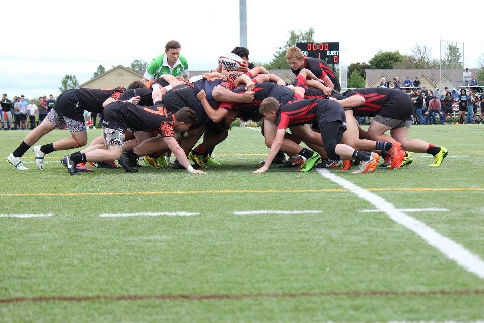 Valley Rams (right) in the scrum against the Beaverton Barbarians (left).