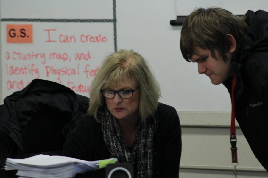 Teacher, Brenda VanderZanden helps one of her many freshmen