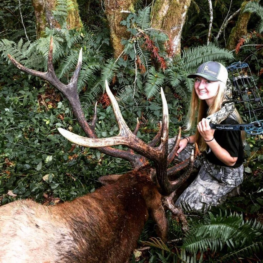 Ashley warden poses with her 6x7 bull elk from the Siuslaw Unit in Southern Oregon.