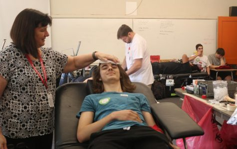 Senior, Caleb Stepper, doing power red for the blood drive