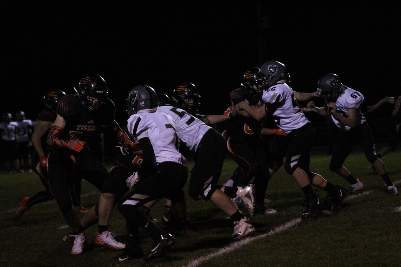 YCHS Boys Football team holds the line against Salem Academy