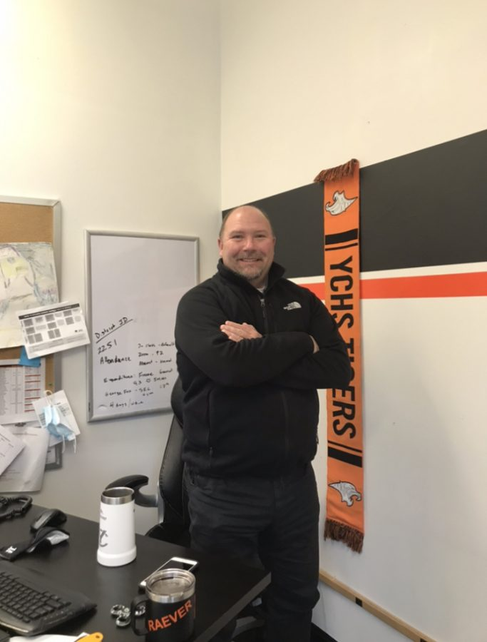 Principal Clint Raever at his desk in Yamhill Carlton high school's office.